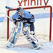 Martin Ouellette #51 of the Maine Black Bears in net during the game at Matthews Arena on February 22, 2014 in Boston, Massachusetts. (Photo by Elan Kawesch)
