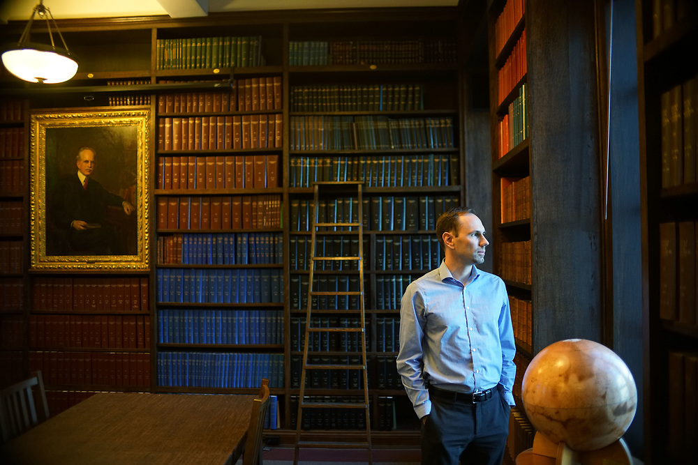 Tony Piro stands in the library at the Carnagie Institute in Pasadena, CA on Tuesday, December 12, 2017.(Photo by Sandy Huffaker)