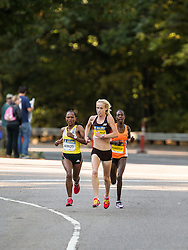 Boston Athletic Association Half Marathon; eventual winner Kim Smith, New Zealand, leads Kiros and Kumutai near 4 miles