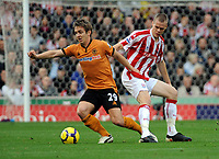 Britannia Stadium Stoke City v Wolverhampton Wanderers 31/10/09<br /> Ryan Shawcross  (Stoke)  Kevin Doyle (Wolves)<br /> Photo Roger Parker Fotosports International