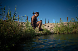 Summer Marie Sunshine Nickrand, 14  jumps in a river on the Moapa reservation outside Las Vegas, Nevada in July, 2012. They don't get to go outside as often as they like because of the poor air quality. In the photos are: Ayona Hernandez, (wearing glasses)13, Aaliya Hernandez , 16, (grey shirt in ponytail)Gyiel Hernandez, 7, (Small boy)  Surita Hernandez, (mother) 37, Zayda Hernandez, (black shirt) 14,  Edgar Perez, 16, Summer Marie Sunshine Nickrand, 14  and Ayasha Hernandez, 4 and on the Moapa reservation in Nevada. All of their family suffers from Asthma and though they can't prove it, believe its because of the coal plant next door. Her grandfather died in march because of cancer. The Sierra Club is working with the Moapa Band of Paiutes to transition NV Energy away from the Reid Gardner coal-fired power plant -- which sits only 45 miles from Las Vegas and a short walk from community housing at the Moapa River Indian Reservation. The Reid Gardner coal plant is literally spewing out tons of airborne pollutants such as mercury, nitrous oxide, sulfur dioxide, and greenhouse gases. This has resulted in substantial health impacts on the Moapa community, with a majority of tribal members reporting a sinus or respiratory ailment. Vernon Lee believes that the many people on the Moapa reservation suffering from health issues are because of the coal plant next door. Sierra Club is working with the Moapa Band of Paiutes to transition NV Energy away from the Reid Gardner coal-fired power plant -- which sits only 45 miles from Las Vegas and a short walk from community housing at the Moapa River Indian Reservation. The Reid Gardner coal plant is literally spewing out tons of airborne pollutants such as mercury, nitrous oxide, sulfur dioxide, and greenhouse gases. This has resulted in substantial health impacts on the Moapa community, with a majority of tribal members reporting a sinus or respiratory ailment.