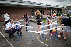 © Licensed to London News Pictures . 14/06/2016 . Blackburn , UK . Yvette Cooper MP and her husband , former MP Ed Balls (pictured racing toy cars in the playground) , campaign for Remain , in the EU referendum , at Shadsworth Children's Centre in Blackburn . Photo credit : Joel Goodman/LNP