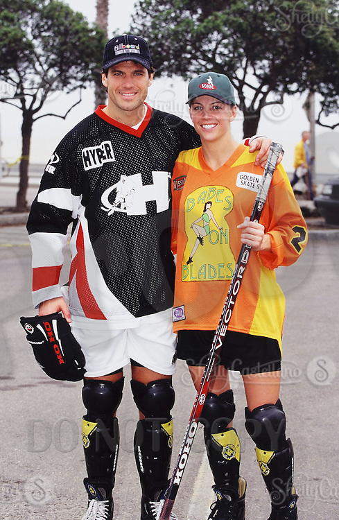 1996:  Pat and Kim Brisson during NHL Breakout grass roots program.  Hockey at the beach in Santa Monica, CA.  Southern California summer sport. Transparency slide scan.