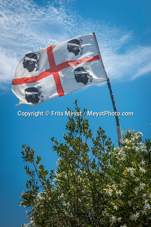 Costa Rei, Sardinia, Italy, June 2015. The flag of Sardinia. Costa Rei is located on the south coast of Sardinia about 50km from Cagliari. The coastline is renowned for its crystal clear water, golden sands and long beaches. Photo by Frits Meyst / MeystPhoto.com
