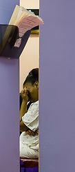 A patient sits in the waiting area before her abortion procedure, at the Jackson Women's Health Organization, on Tuesday August 19, 2014, in Jackson, Mississippi. This is the only clinic in the entire state that performs abortions. (Photo © Jock Fistick)