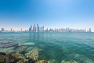 Dubai skyline looking across the sea to Dubai Marina, United Arab Emirates.