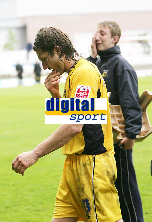 Photo: Rich Eaton.<br /> <br /> Oxford United v Leyton Orient. Coca Cola League 2. 06/05/2006.<br /> <br /> Oxford United captain Chris Hargreaves leaves the pitch after his team is relegated from the football league and a United ballboy in background is clearly upset.