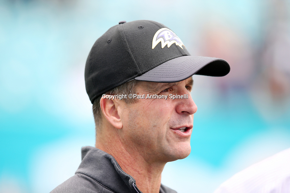 Baltimore Ravens head coach John Harbaugh talks on the sideline before the 2015 week 13 regular season NFL football game against the Miami Dolphins on Sunday, Dec. 6, 2015 in Miami Gardens, Fla. The Dolphins won the game 15-13. (©Paul Anthony Spinelli)