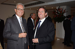Left to right, SIR CHRISTOPHER GENT and DR LIAM FOX at the Conservative party Pre-Conference Season party hosted by Lord Saatchi and Lord Strathclyde and held at M&C Saatchi, 36 Golden Square, London W1 on 7th September 2004.