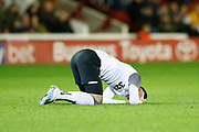 Tom Lawrence of Derby County goes down after taking a knock during the EFL Sky Bet Championship match between Barnsley and Derby County at Oakwell, Barnsley, England on 2 October 2019.