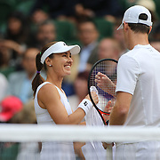 LONDON, ENGLAND - JULY 14: Martina Hingis of Switzerland in action with Jamie Murray of Great Britain during the Mixed Doubles Semi Final on Center Court during the Wimbledon Lawn Tennis Championships at the All England Lawn Tennis and Croquet Club at Wimbledon on July 14, 2017 in London, England. (Photo by Tim Clayton/Corbis via Getty Images)