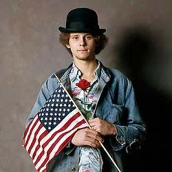 young hippie with american flag bowler hat and red roses
