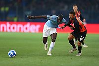 KHARKOV, UKRAINE - OCTOBER 23: Benjamin Mendy of Manchester City battles with Wellington Nem of Shakhtar Donetsk  during the Group F match of the UEFA Champions League between FC Shakhtar Donetsk and Manchester City at Metalist Stadium on October 23, 2018 in Kharkov, Ukraine. (Photo by MB Media/Getty Images)