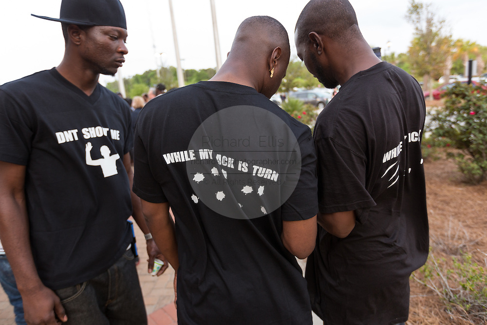 Activists wear a protest message on a shirt during a vigil outside the North Charleston City Hall following the shooting death of Walter Scott April 10, 2015 in Charleston, South Carolina. Scott was shot multiple times by police after running from a traffic stop.