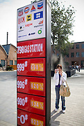 Visitors take snaps of an installation resembling a gas station in Beijing's trendy 798 art district in northern Beijing.