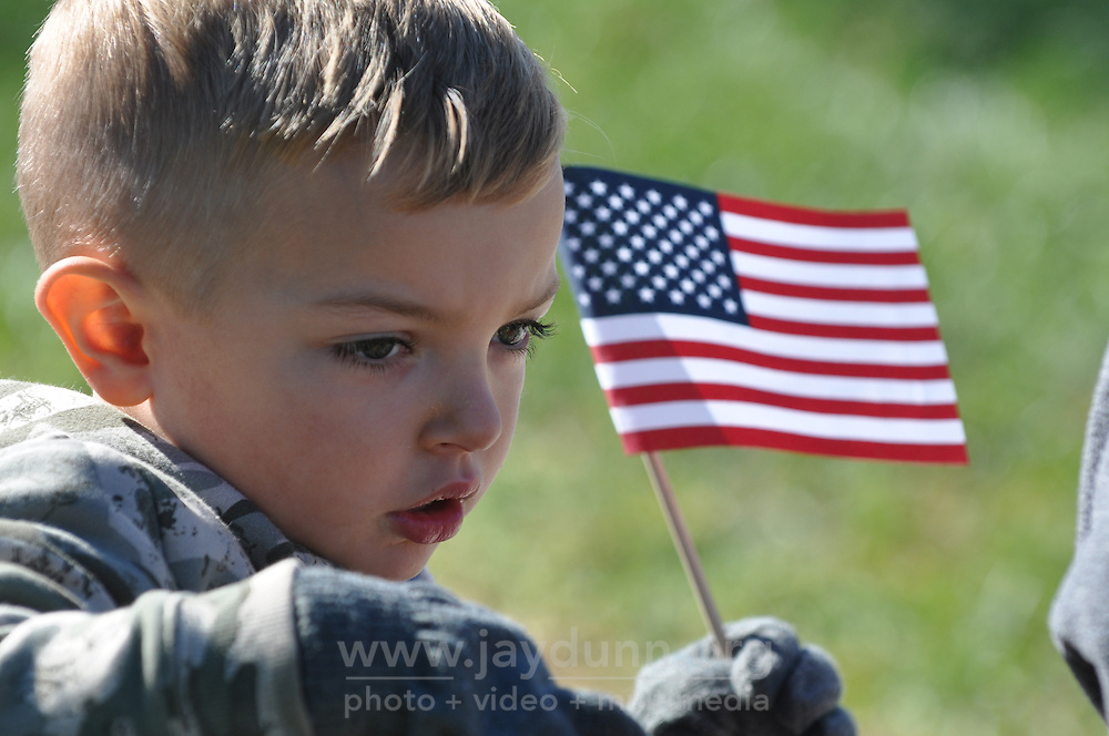 A child takes a few moments during the Veterans Day ceremony on Wednesday at the Monterey County Vietnam Veterans Memorial in Salinas.