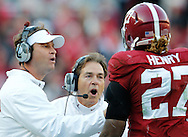 Nov 15, 2014; Tuscaloosa, AL, USA; Alabama Crimson Tide offensive coordinator Lane Kiffen , head coach Nick Saban lecture Alabama Crimson Tide running back Derrick Henry (27) after he had supposedly fumbled short of the goal line, after the officials further review it was ruled a touchdown against Mississippi State Bulldogs at Bryant-Denny Stadium. Mandatory Credit: Marvin Gentry