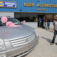 Lauren Ward gets her first look at the Cadillac SRX she won by submitting an essay to the NAPA AutoCare Centers of Northeast Mississippi that explained why why their mother deserved a reliable car.