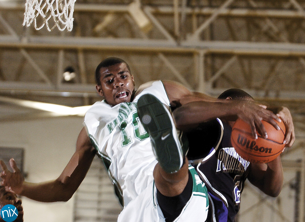 A.L. Brown's T.J. Johnson fights Porter Ridge's Travis Evans for a rebound Tuesday night in Kannapolis.