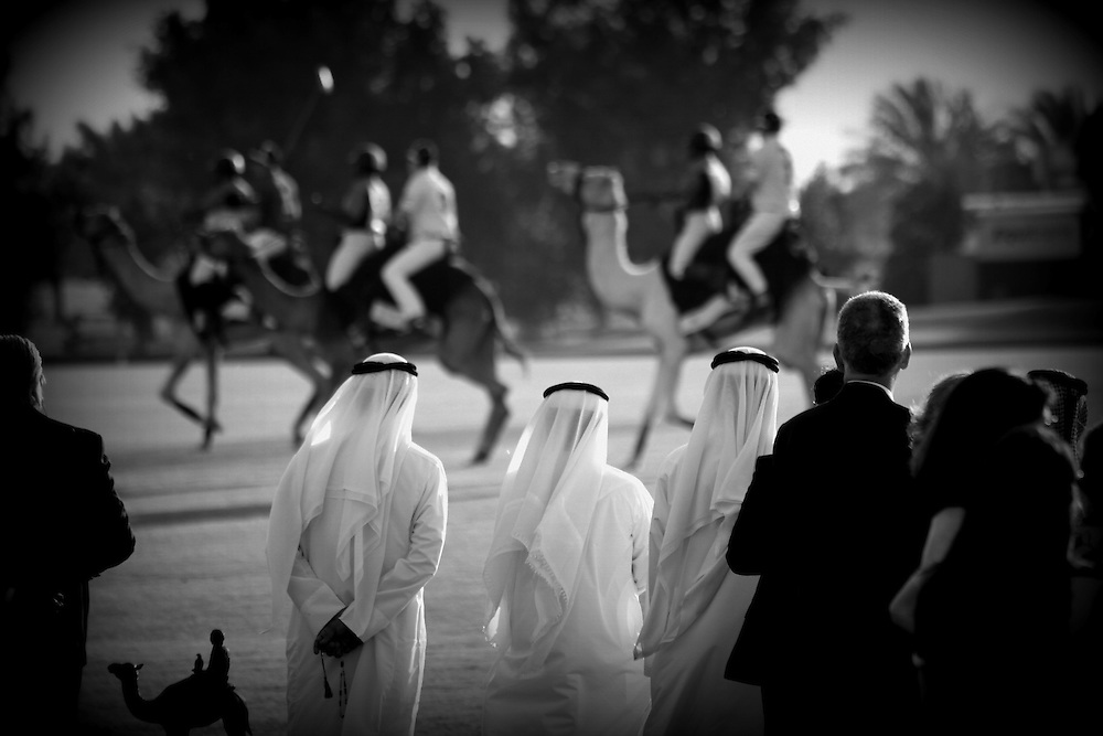 Sheikhs watch the camel polo action at Ghantoot polo club.