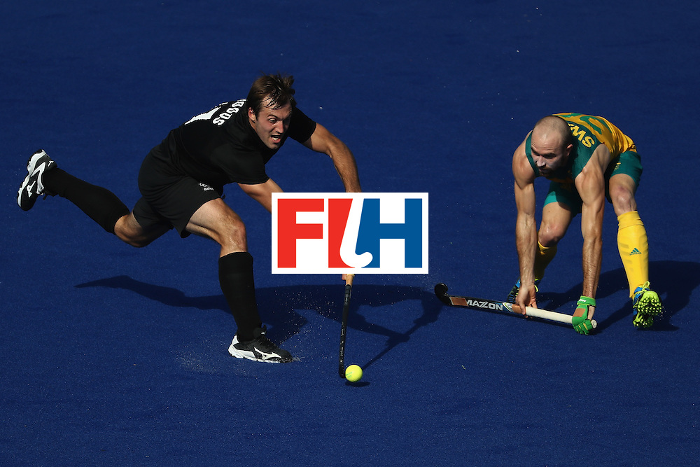 RIO DE JANEIRO, BRAZIL - AUGUST 06:  Nic Woods #17 of New Zealand passes past Matthew Swann #20 of Australia during a Pool A match between New Zealand and Austraiia  on Day 1 of the Rio 2016 Olympic Games at the Olympic Hockey Centre on August 6, 2016 in Rio de Janeiro, Brazil.  (Photo by Sean M. Haffey/Getty Images)