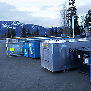 "Winter Olympics, Vancouver, 2010.Bobsleigh containers outside the venue during the Bobsleigh Four-man competition  at The Whistler Sliding Centre, Whistler, during the Vancouver Winter Olympics. 25th February 2010. Photo Tim Clayton..'BOB'..Images from the Four-man Bobsleigh Competition. Winter Olympics, Vancouver 2010..History was made at the Whistler Sliding Centre when the USA four-man bobsleigh team, led by Steven Holcomb took the Gold. The first time since 1948, a gap of 62 years, since the USA have won an Olympic Bobsleigh gold and they did it with their sleigh named ""Night Train""...The four days of practice and competition show the tension, nervousness and preparation as the teams of hardened men cope with the challenge of traveling at average speeds of over 150 km an hour. Indeed, five teams had already pulled out of the event before the opening heats because of track complexity, speed and fear, and on the final day, another four teams did not start after six crashes in the first two heats...Teams warm up behind the start complex, warming muscles in the cold in preparation for the explosive start. Many teams prepare in silence, mentally preparing themselves as they wait at the top of the run, in the bobsleigh sheds and the loading areas for their turn. When it's time to slide each team performs it's own starting ritual, followed by the much practiced start out of the blocks for just over four seconds, the teams are then in the hands of the accomplished drivers as they hurtle down the track for just over fifty seconds...Spectators clamber for the best position on track to see the sleighs for a split second, many unsuccessfully try to capture the moments on camera, The rumble of the sleigh is heard then the crowds gasp as it hurtles past in a blur...The American foursome of  Steven Holcomb, Justin Olsen, Steve Mesler and Curtis Tomasevicz finished with a pooled four-heat time of 3min 24.46sec. The German team led by Andre Lange won the Silver Medal in a combin"