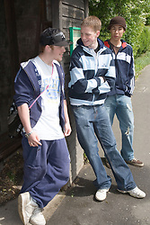 Group of teenage boys waiting for a bus,