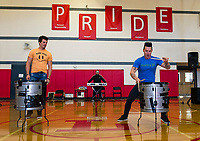 Ryan Vezina watches Justin Spencer of Recycled Percussion as he performs a drum duel during a surprise visit to Laconia Middle School Monday afternoon.  (Karen Bobotas/for the Laconia Daily Sun)