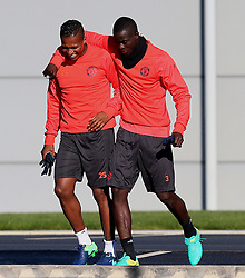 Antonio Valencia shares a joke with Eric Bailly of Manchester United  - Mandatory by-line: Matt McNulty/JMP - 19/10/2016 - FOOTBALL - Manchester United - Training session ahead of Europa League game against Fenerbahce