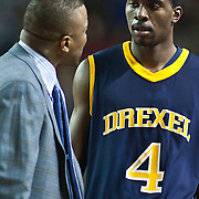 12/03/11 Newark DE: Drexel Head Men's Basketball Coach James Flint (Left) speaks to Drexel guard Frantz Massenat #4 during a Colonial Athletic Association conference basketball game, Saturday, Dec. 03, 2011 at the Bob carpenter center in Newark Delaware...Sophomore Guard #10 Devon Saddler would finish the game with 30 total points, Delaware defeat Drexel 71-60.
