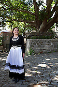 Panayota MIhou in front of the oldest platanus tree of Vovousa village. She came to the village to work at one of the local restaurants and she has adjusted so well that is almost considered a local. She enjoyes the peaceful friendliness of the people and the beautiful nature that surrounds the village.