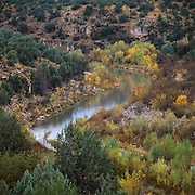 Rain dances on the Verde River in central Arizona as it flows past trees in fall colors