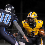 Cape Fear's Antonio Burden rushes against Hoggard's Will Kandare Friday November 21, 2014 at Hoggard High School in Wilmington, N.C. (Jason A. Frizzelle)