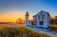 Sunset across the Puget Sound at Admiralty Head Lighthouse in Fort Casey State Park on Whidbey Island, Washington