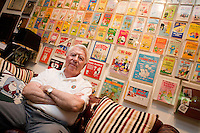 """19 June, 2008. Stamford, CT. Cartoonist Mort Walker, 85, sits on the couch of his home-studio in front of the wall exhibiting his most famous comics, such as """"Beetle Bailey"""" and """"Hi and Lois"""". On June 20th Mr. Walker will be moving his National Comic Museum collection from a warehouse in Stamford to a Ohio State University library. Mr. Walker is the creator """"Beetle Bailey"""", one of the oldest comic strips still being produced by the original creator. The museum was established by Mr. Walker in 1976. Since then he collected over 200.000 pieces, including comic books, new clippings, drawings, film footage and posters.<br /> ©2008 Gianni Cipriano for the Wall Street Journal<br /> cell. +1 646 465 2168 (USA)<br /> cell. +1 328 567 7923 (Italy)<br /> gianni@giannicipriano.com<br /> www.giannicipriano.com"""