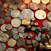 A collection Tudor coins excavated from the River Thames by mudlarker Jason Sandy is displayed in his home in London, Britain June 01, 2016. When the river Thames is at low tide, mudlarkers scour the shore for historical artefacts and remains from there City of London's ancient past. Finds can date back to Roman times to when the city was found up until more recent times. Anyone can walk along the river and look for finds, but the uses of metal detectors and digging is restricted. Mudlarkers need to be licences by the Port of London Authority. All find should be register with the Museum of London. REUTERS/Neil Hall