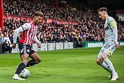 Oliver Watkins (Brentford) & Tom Lawrence (Derby County)  during the EFL Sky Bet Championship match between Brentford and Derby County at Griffin Park, London, England on 6 April 2019.