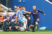Everton striker Wayne Rooney (10) battles with Brighton and Hove Albion midfielder Pascal Gross (13) during the Premier League match between Brighton and Hove Albion and Everton at the American Express Community Stadium, Brighton and Hove, England on 15 October 2017. Photo by Phil Duncan.