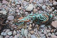 Fishing refuse litters a beach