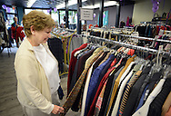 DOYLESTOWN, PA - AUGUST 23:  Jo-Ann Pagel of Doylestown, Pennsylvania browses a clothing rack at the grand opening of In Full Swing, A Woman's Place's newly designed and relocated thrift shop August 23, 2014 in Doylestown, Pennsylvania. (Photo by William Thomas Cain/Cain Images)