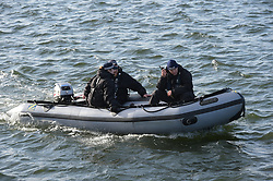 © Licensed to London News Pictures. 10/10/2019. London UK: Police are seen on the water surrounding London City Airport as Extinction Rebellion protesters move east across the capital to blockade the  airport. Police are stopping protesters from shutting down the airport as their campaign enters its forth day , Photo credit: Steve Poston/LNP