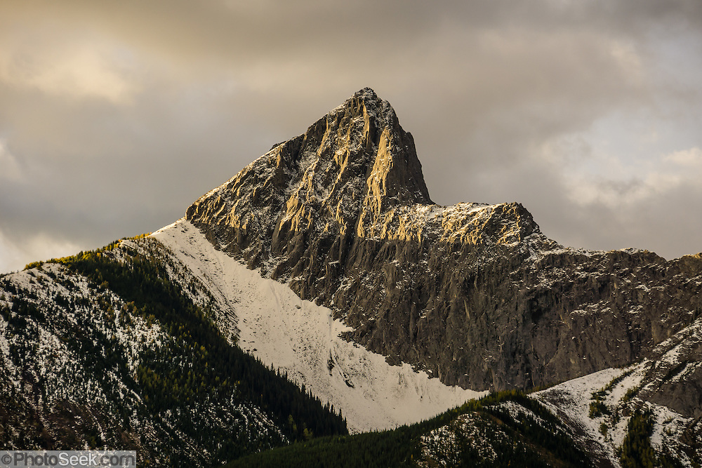 Sunrise light spotlights the Wedge (2665 m or 8743 ft) in the Fisher Range above Kananaskis River at Mt Kidd RV Park, in the Canadian Rockies, Alberta, Canada. Kananaskis Country is a park system west of Calgary.