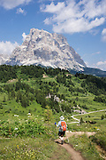 See Monte Pelmo (3169 meters or 10,397 feet) from hikes on Monte Civetta, starting from Alleghe village's lift, in the Dolomites, Belluno province, Veneto region, Italy. The Dolomites or Dolomiti are part of the Southern Limestone Alps in Europe. UNESCO honored the Dolomites as a natural World Heritage Site in 2009.