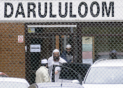 © Licensed to London News Pictures. 10/06/2013 Visitors coming and going at the school today. Police on scene protecting Darul Uloom School today (10.06.2013) after a suspicious fire.  Four teenagers have been arrested. Photo credit :Grant Falvey/LNP