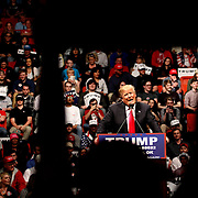 Republican presidential candidate Donald Trump is framed by a supporter holding up sign as he speaks during his rally at the Cox Convention Center in Oklahoma City, Oklahoma, on Feb. 26, 2016. Kurt Steiss/O'Colly