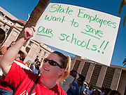 27 JUNE 2009 -- PHOENIX, AZ: An Arizona teacher during a march at the Arizona state capitol Saturday. Arizona has the second worst state budget deficit in the country (only California's is worst) and the Republican controlled legislature is threatening to balance the budget by making massive cuts in social and education spending while cutting taxes. Small numbers of public school teachers and parents of public school students have been marching on the capitol almost every day of the week but Saturday's march, with well over 500 people was the largest of session. The legislature and Gov. Jan Brewer, also a Republican, are deadlocked in negotiations and the Governor has threatened to shut down state government on July 1 if there is no budget. Republican leaders in the legislature are threatening to present the Governor with a budget, without input from the Governor's office, at midnight on June 30, forcing her to sign the budget to keep the state open.  Photo by Jack Kurtz