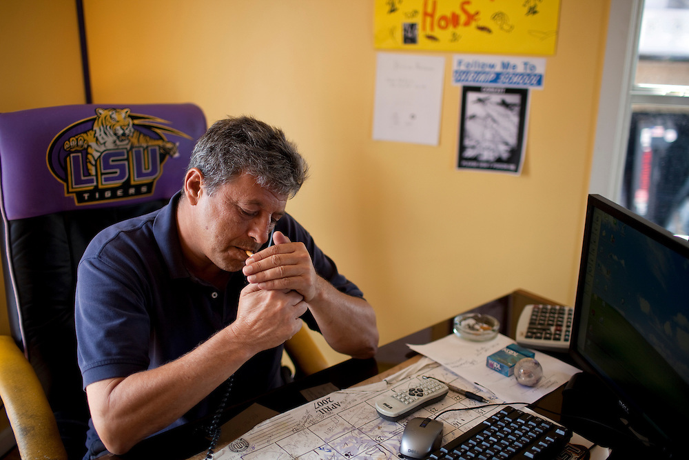 Dean Blanchard, owner of  Seafood Inc. of Dean Blanchard Seafood, Inc. lights a cigarette while on the phone in Grand Isle, LA on June 24, 2010 where a fishing ban has been put in place due to the B.P. oil spill. Blanchard said the ban has forced him to lay off almost 80 of his workers.