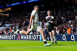 England Winger Jonny May kicks the ball away in celebration after scoring a try - Mandatory byline: Rogan Thomson/JMP - 07966 386802 - 15/08/2015 - RUGBY UNION - Twickenham Stadium - London, England - England v France - QBE Internationals 2015.