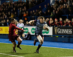 Cardiff Blues' Owen Lane evades the tackle of  Munster's Ian Keatley to run his sides third try<br /> <br /> Photographer Simon King/Replay Images<br /> <br /> Guinness PRO14 Round 15 - Cardiff Blues v Munster - Saturday 17th February 2018 - Cardiff Arms Park - Cardiff<br /> <br /> World Copyright © Replay Images . All rights reserved. info@replayimages.co.uk - http://replayimages.co.uk