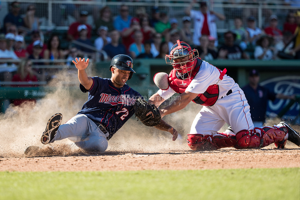 FORT MYERS, FL- FEBRUARY 25: Leonardo Reginatto #72 of the Minnesota Twins is tagged out by Dan Butler #70 of the Boston Red Sox on February 25, 2017 at JetBlue Park in Fort Myers, Florida. (Photo by Brace Hemmelgarn) *** Local Caption *** Leonardo Reginatto;Dan Butler